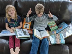 Josephine & Matthew Bostic enjoy books borrowed on the first day of Curbside Service, May 18, 2020